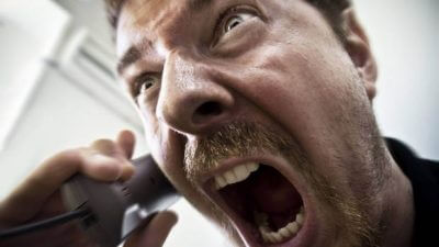 angry man shouting down phone
