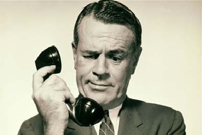 Man looking bemused whilst on the phone