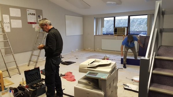 Contractors at work readying JFM's improved office space
